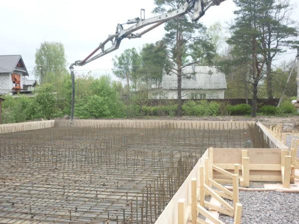 Фундаментная плита: строительство загородного дома