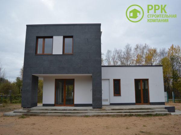 Дом в стиле кубизм. Фасад из керамогранита и штукатурки ATLAS.