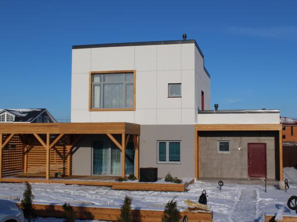 Дом в современном стиле с открытой террасой.